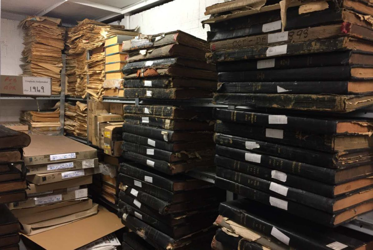 Stacks of newspaper volumes in the depot of the Irish Newspaper Archives